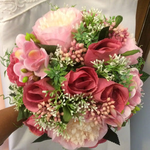 A wedding bouquet of artificial silk pink peony