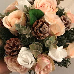 A winter bouquet of white and blush roses
