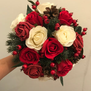 A Christmas wedding bouquet of artificial red and ivory roses