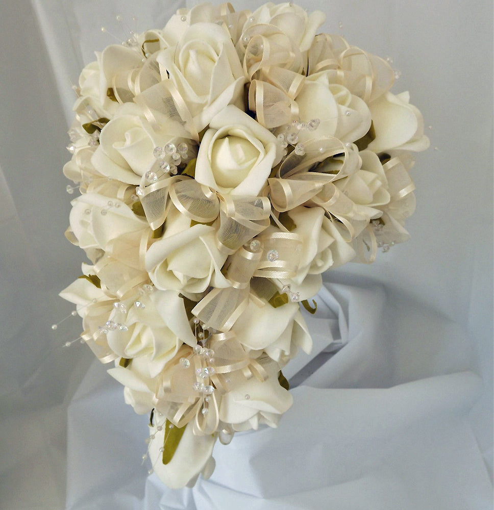an artificial shower bouquet featuring Ivory foam roses, crystals and pearls
