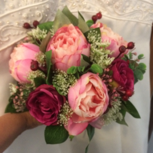 A wedding bouquet of silk pink peony & wine coloured roses
