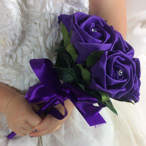 flower girls posy of purple foam roses