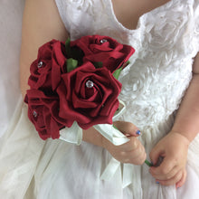 a bridesmaids posy featuring artificial red foam roses with crystal centres