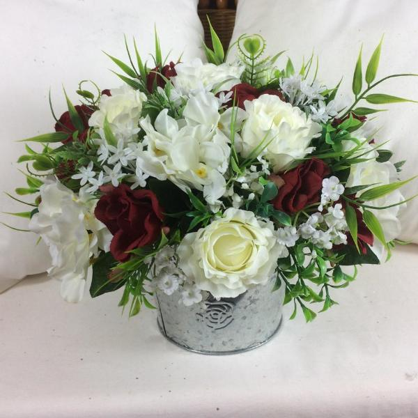 flower center piece of red and ivory roses