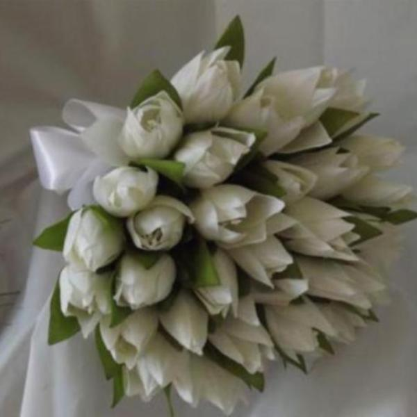 a wedding bouquet of artificial silk white tulips