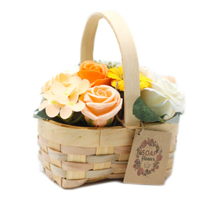 peach orange soap flowers arrangement in wicker basket