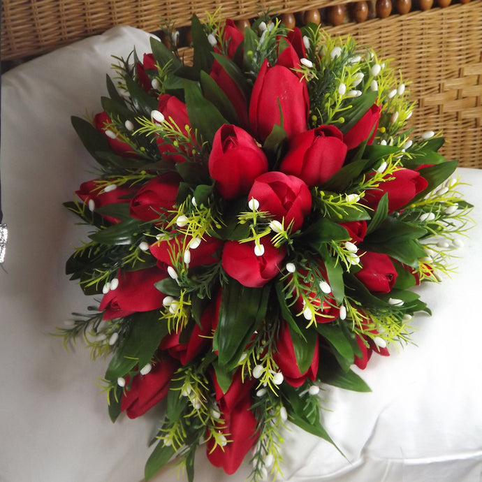 an artificial shower bouquet featuring red silk tulips