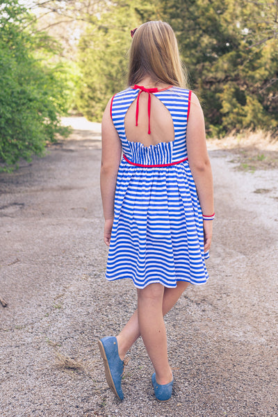 royal and white striped dress with red piping and smocked open back