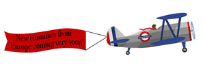 "Cartoon Airplane with Banner that says ""New container from Europe coming very soon!"""