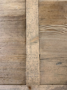 Close up of Wood Top of Reclaimed Light Wood Dining Table