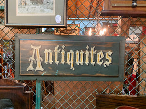 Hand-painted Antiquities sign, green and white