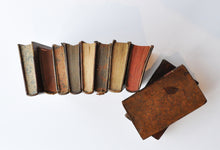 The top of a group of vintage French leather bound books.