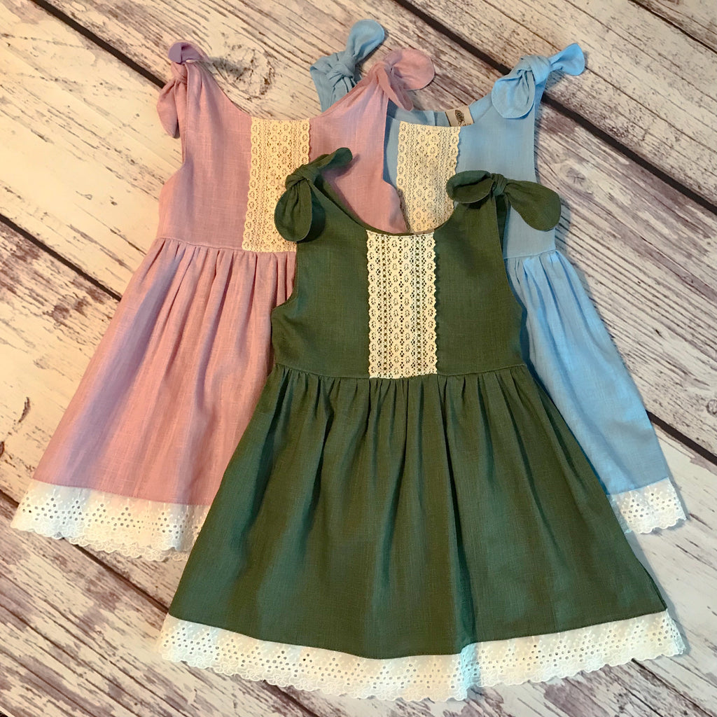 Boho style linen dresses in dusty pink, olive green, and wedgewood blue. White eyelet trim. Ivory cotton lace.
