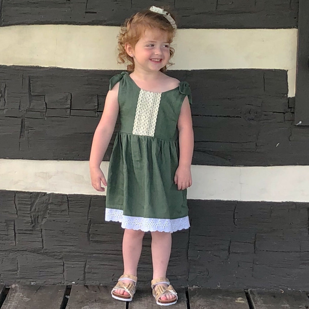 Little girl in olive green boho dress