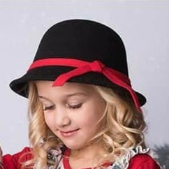 LIttle girl wearing our black with red trim cloche hat