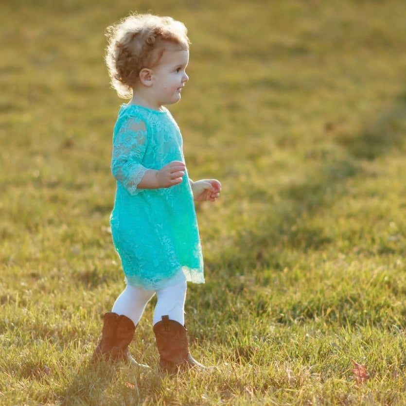 Baby girl in aqua lace dress and cowboy boots