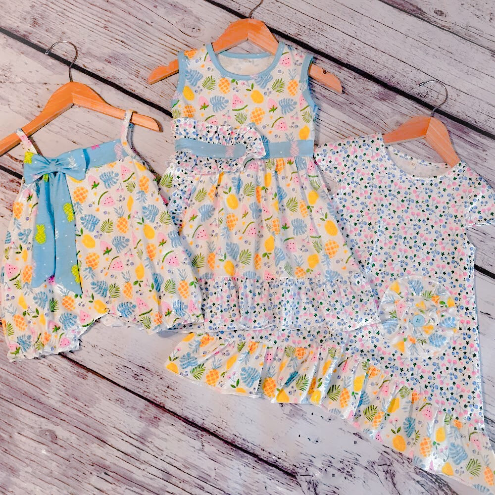 Collage of our matching fruits et fleurs dresses and bubble; matching sister sets