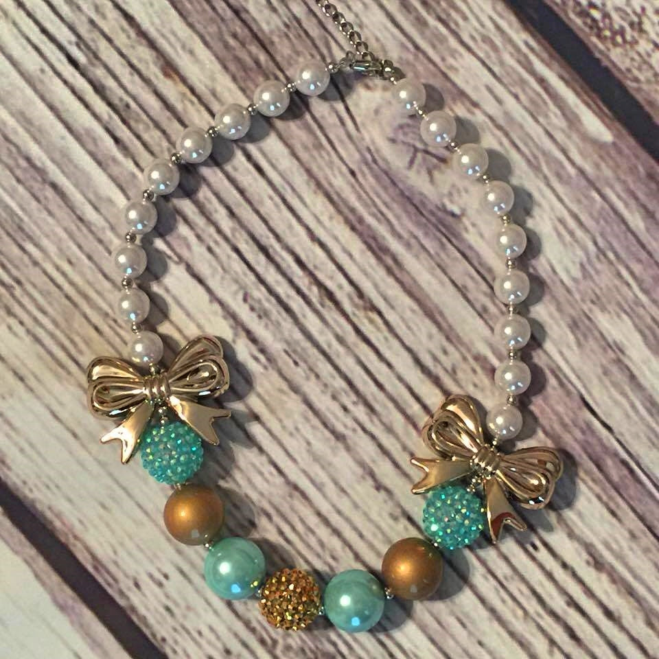 Turquoise, gold, and pearls with gold bows chunky bead necklace