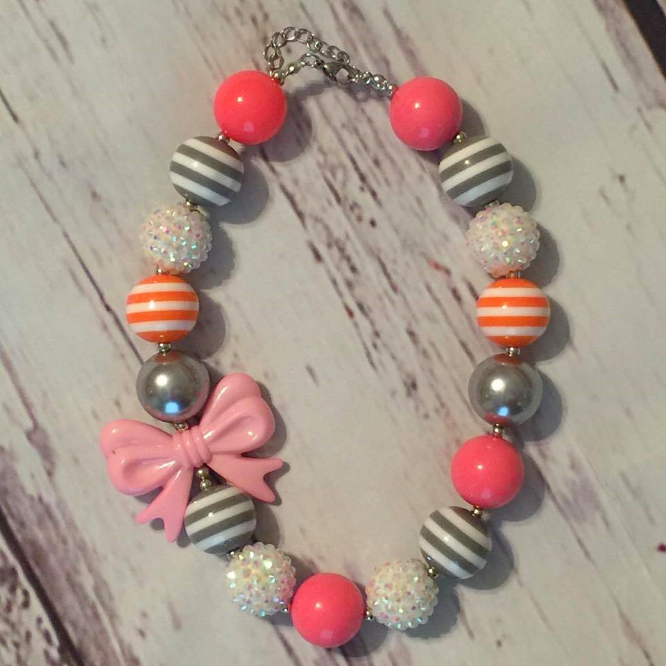 pink, orange, and gray/white striped beads with pink bow chunky bead necklace