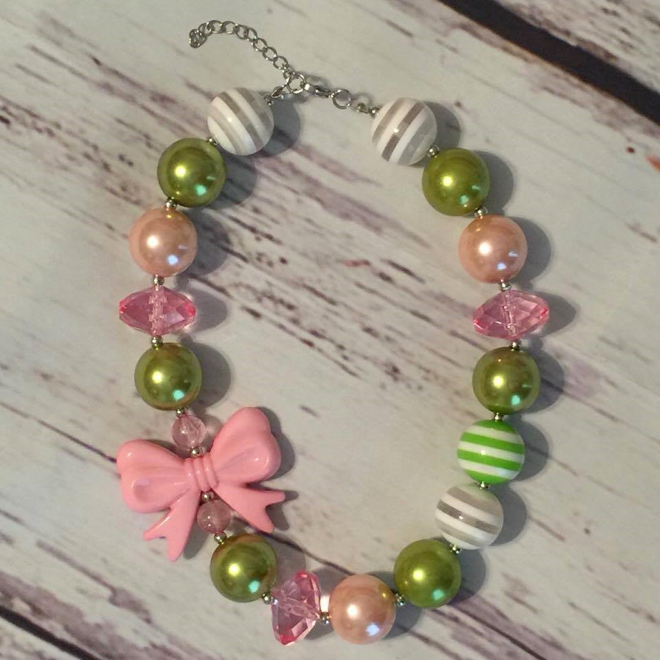 pink, green, green/white striped, and gray/white striped with pink bow chunky bead necklace