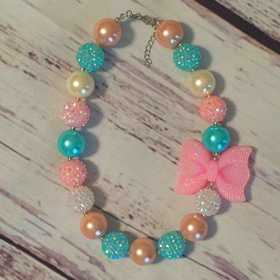 turquoise, pink, and pearl beads with pink sparkly bow chunky bead necklace