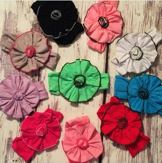 "Stretchy cotton headbands with 6"" flowers in solid colors with coordinating colors serged edges"