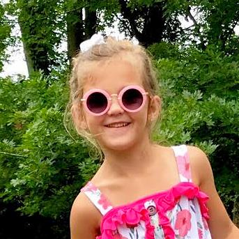 Little girl wearing our pink boho style sunglasses