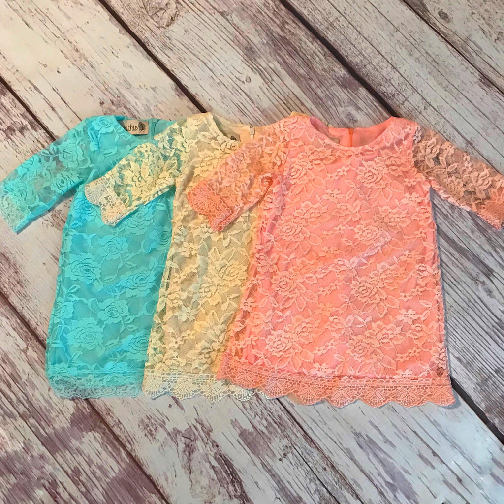 Lace dresses in aqua, ivory, and peach