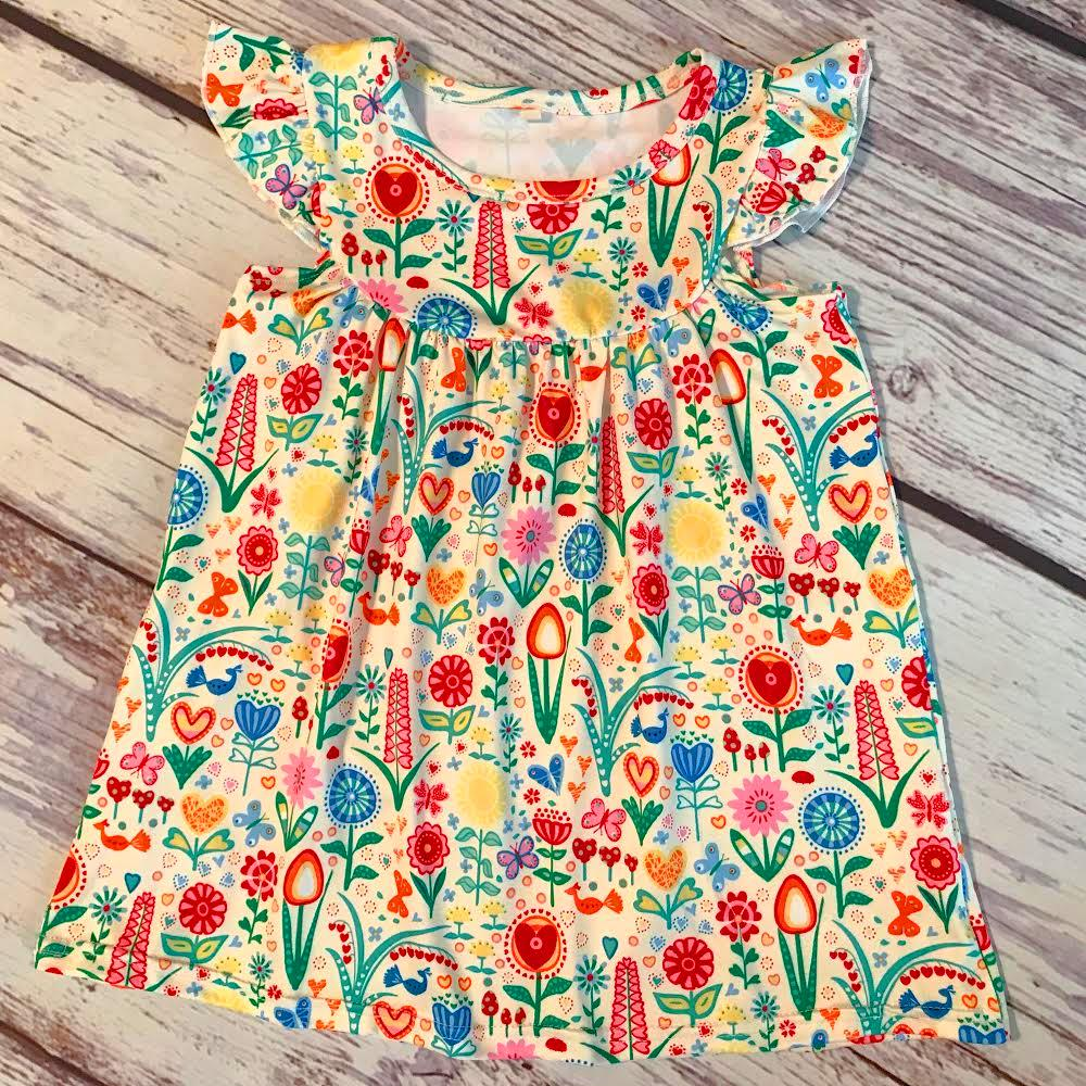 Flutter sleeve lap dress with a bright, multi-color dutch garden style print