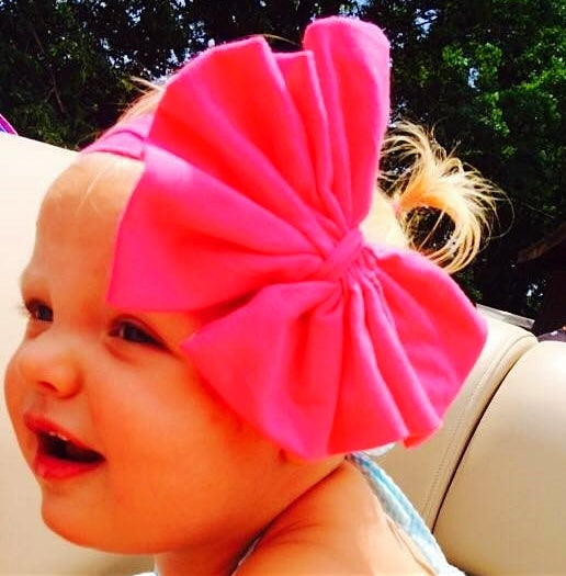 baby girl wearing messy bow headband in bubblegum pink