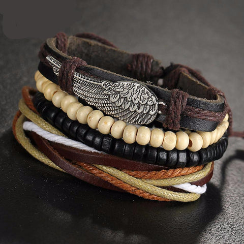 Wing bracelet with 2 other beaded and leather bracelets.
