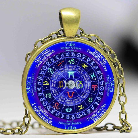 Wiccan zodiac calendar necklace in antique bronze.