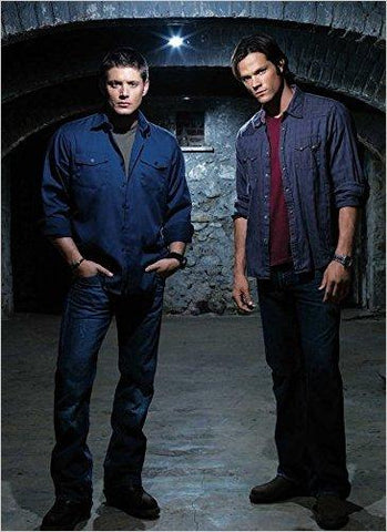Sam and Dean standing together.