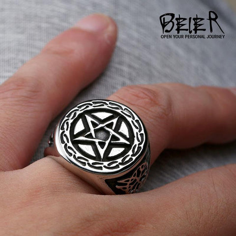 Pentagram ring on a man's hand.