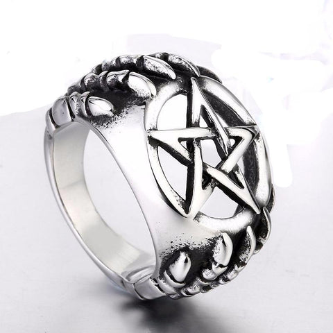Dragon claw with pentagram ring front edge view.