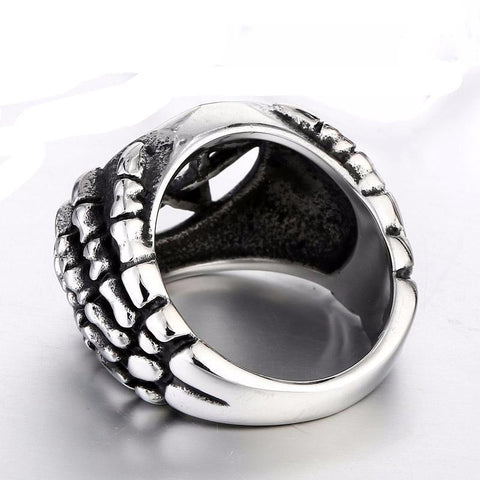 Dragon claw with pentagram ring back view.