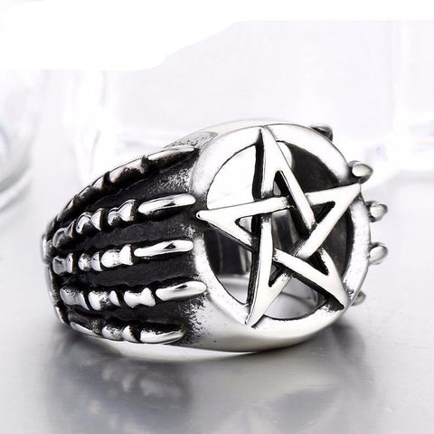 Dragon claw with pentagram ring front view.