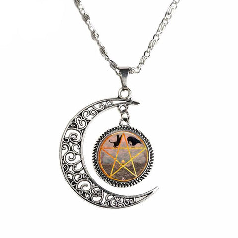 Crescent Moon pendant with cat, crow and pentagram center.