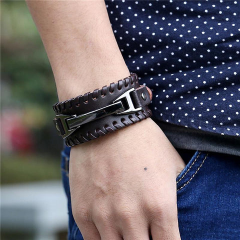 Picture of leather and metal men's bracelet being worn.