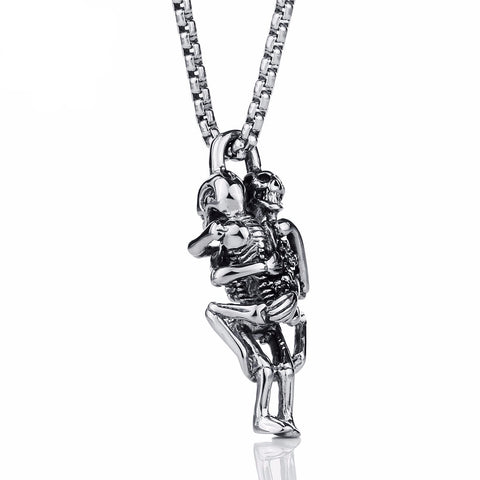 Picture of two skeletons hugging necklace against white background.