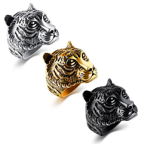 Picture of three tiger rings in the gold, silver and black.