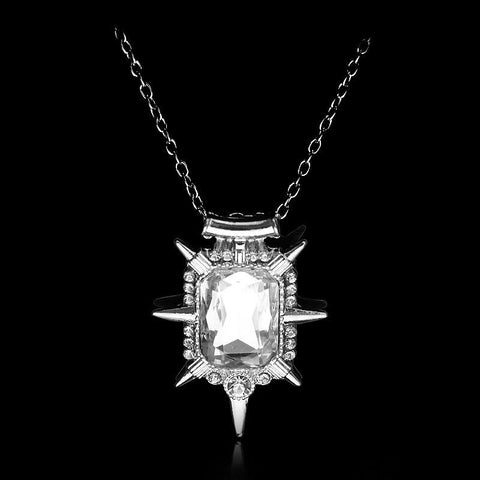 White witch necklace on a black background.