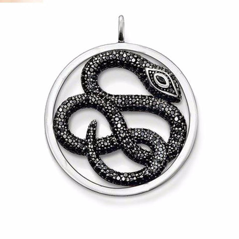 Black pave zirconia snake necklace surrounded by silver.
