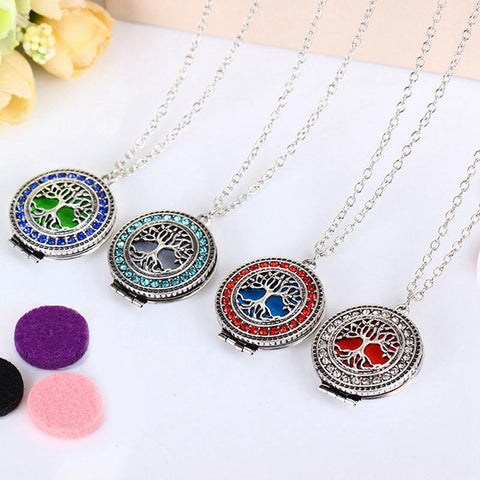 Picture of 4 tree of life necklaces in different colors of rhinestones.