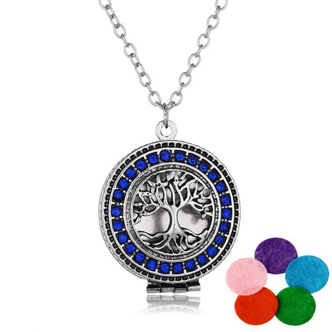 Blue rhinestone tree of life pendant.