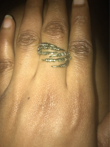 Picture of eagle claw ring being worn by a person.