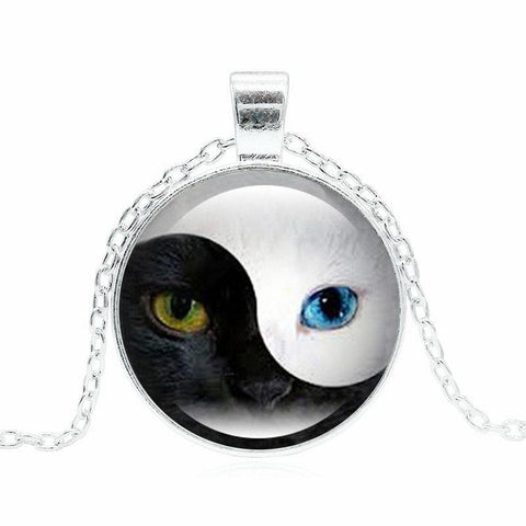 Yin and Yang blue-eyed cat necklace in silver.