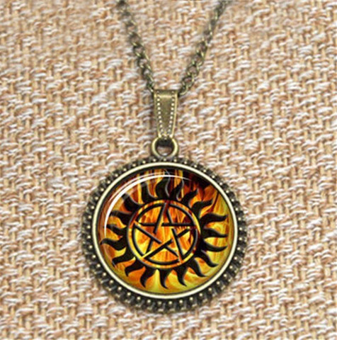 Supernatural fire anti-possession pendant in vintage bronze.