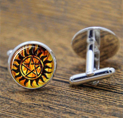 Supernatural fire anti-possession pendant in silver cuff links.