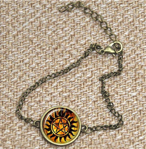 Supernatural fire anti-possession pendant in bronze bracelet.